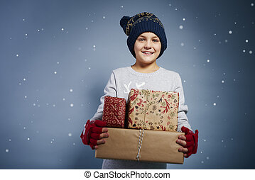 Portrait of boy holding christmas present