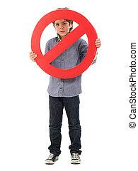 Portrait Of Boy Holding Prohibit Sign