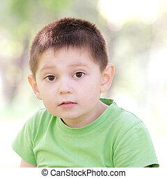 Portrait of boy in green