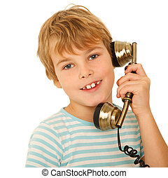 Portrait of boy in T-shirt talking to retro phone against white background. Isolation.