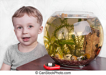 Portrait of boy near aquarium - Portrait of a smiling boy ...