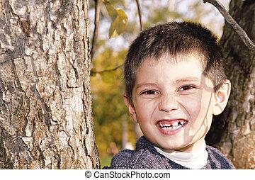 Portrait of boy on tree