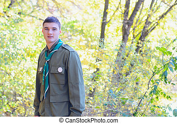 Portrait of Boy Scout in Forest on Sunny Day