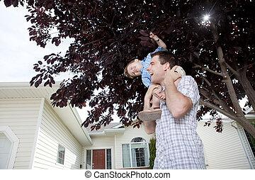 Portrait Of Boy Sitting On Father's Shoulder