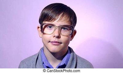 Portrait of boy teenager schoolboy nerd glasses on purple ...