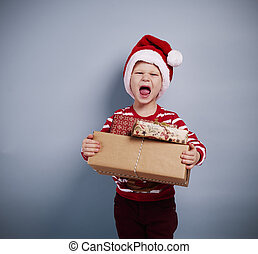 Portrait of boy with christmas gifts
