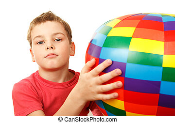 Portrait of boy with colorful inflatable ball on white background.