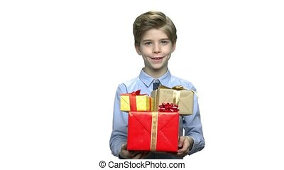 Portrait of boy with gift boxes.