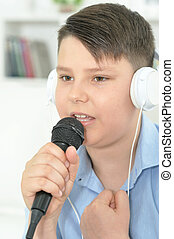 Portrait of boy with microphone