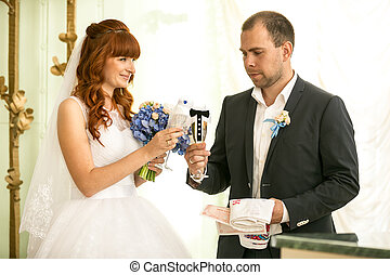 bride and groom holding glasses of champagne