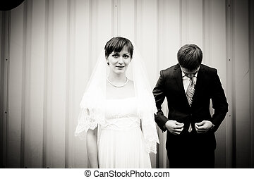 Portrait of bride and groom standing