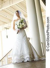 Caucasian mid-adult bride portrait.