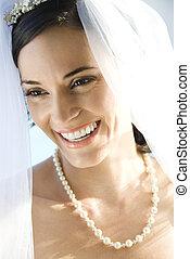 Portrait of Caucasian mid-adult bride smiling.
