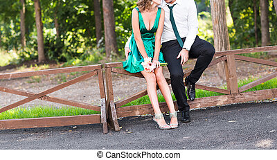 Portrait of bridesmaid and groomsman on wedding at park