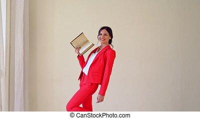 Portrait of brunette woman reading book. Beautiful woman...