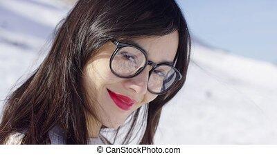 Portrait of brunette woman wearing eyeglasses - Close-up...