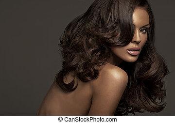 Portrait of brunette woman with dark complexion