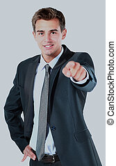 Portrait of business man pointing at you.
