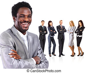Portrait of business man standing together with colleagues and smiling