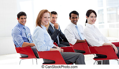 Portrait of business people at a conference