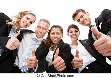 Portrait Of Business People Gesturing Thumbs Up
