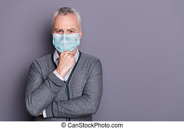 Portrait of business shark wearing casual formal-wear mask touching chin isolated over gray pastel background