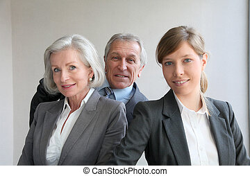 Portrait of business team standing in office