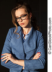 Portrait of business woman in a business suit with goggles