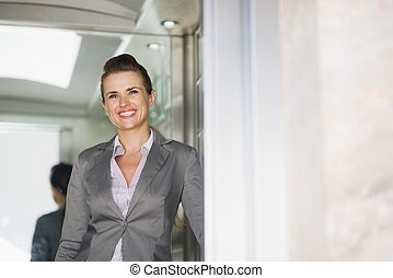 Portrait of business woman in elevator