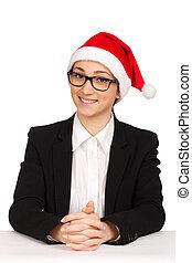 Portrait of business woman in santa hat
