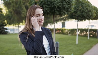 Portrait of Business Woman Making a Phone Call Outdoors