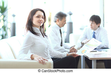 portrait of business woman on the background of colleagues