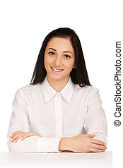 Portrait of business woman sitting on her desk