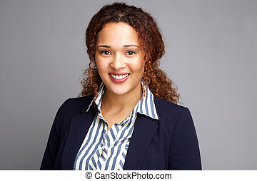 business woman smiling against gray background