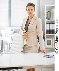 Portrait of business woman standing in office
