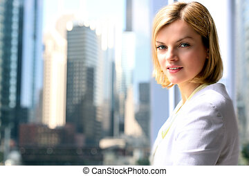Portrait of business woman standing  near window