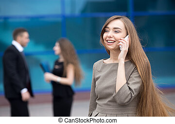Portrait of business woman talking on phone outdoor
