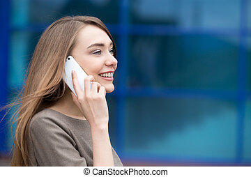 Portrait of business woman using mobile phone. Copy space
