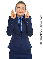 Portrait of business woman with crossed fingers