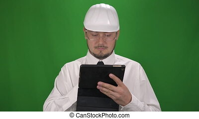 Portrait of Business Worker Man in the white helmet. Green Screen Background
