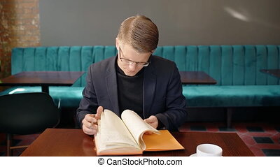 Portrait of businessman checking his meeting schedule in...