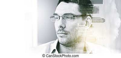 portrait of businessman in eyeglasses at office