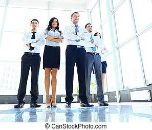 Portrait of businessman leading his team at office