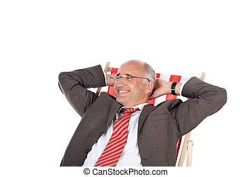 businessman relaxing in desk chair