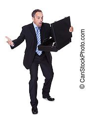 Portrait Of Businessman Shocked By Losing Money From Briefcase
