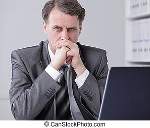 businessman sitting at the desk in office workplace