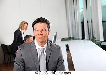Portrait of businessman sitting in meeting room