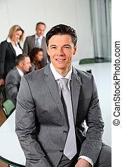 Portrait of businessman sitting in meeting room
