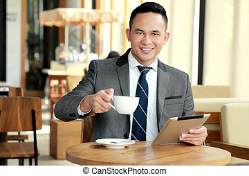 businessman taking a break at coffee shop