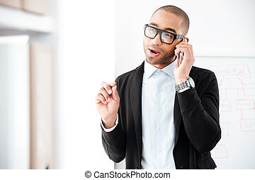 Portrait of businessman talking on the mobile phone